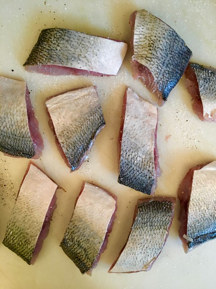 The fish cut into portions. If you use sardines or small mackerel fillets, leave them whole