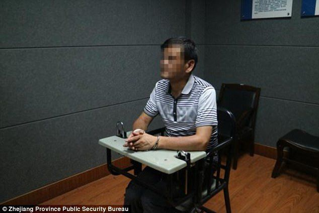 A man identified by Chinese media as author Liu Yongbiao is seen after his arrest.