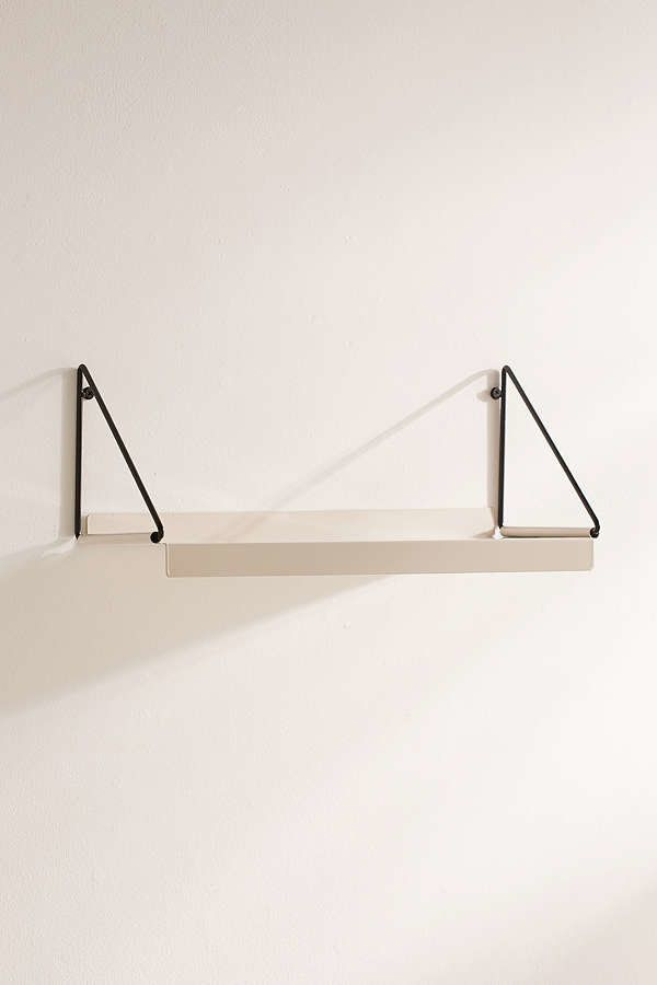 "<a href=""https://www.urbanoutfitters.com/shop/modern-wall-shelf-001"" target=""_blank"">Shop it here.</a>"