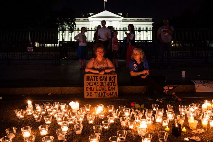 People gather in front of the White House on Aug. 13, 2017, in Washington, D.C., for a vigil in response to the death of