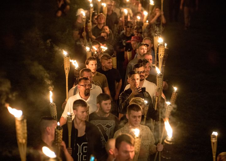 """Chanting """"White lives matter!,"""" """"You will not replace us!"""" and """"Jews will not replace us!"""" several hundred white nationalists and white supremacists carrying torches marched in a parade through the University of Virginia campus."""