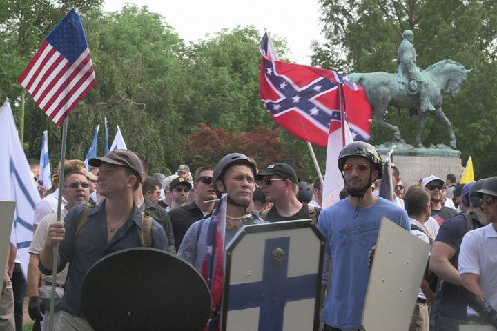 "Demonstrators hold shields and flags during the ""Unite the Right"" rally at Emancipation Park in Charlottesville, Virginia, US"
