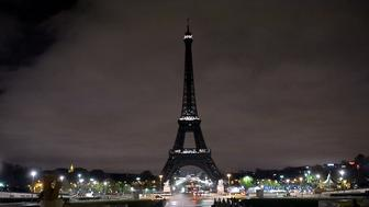 PARIS, FRANCE - NOVEMBER 15:  The Eiffel Tower is seen after turned off its lights in respect for the victims of France terror attacks, on November 14, 2015. The Eiffel Tower has been closed indefinitely following the wave of deadly attacks in Paris. 129 people were killed and 352 others injured -- 99 of them in critical condition -- after the terror attacks in Paris on 13 November. (Photo by Dursun Aydemir/Anadolu Agency/Getty Images)