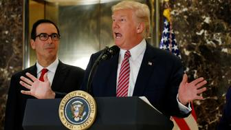 "U.S. President Donald Trump answers questions about his responses to the deaths and injuries at the ""Unite the Right"" rally in Charlottesville as he talks to the media with Treasury Secretary Steven Mnuchin (L) at his side in the lobby of Trump Tower in Manhattan, New York, U.S., August 15, 2017.   REUTERS/Kevin Lamarque"
