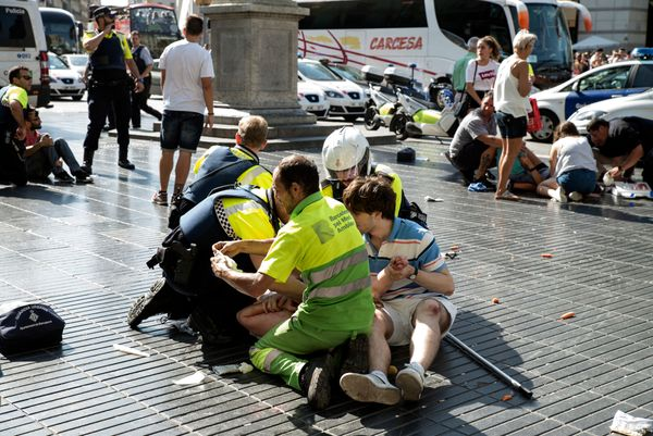 Medics and police tend to injured people.