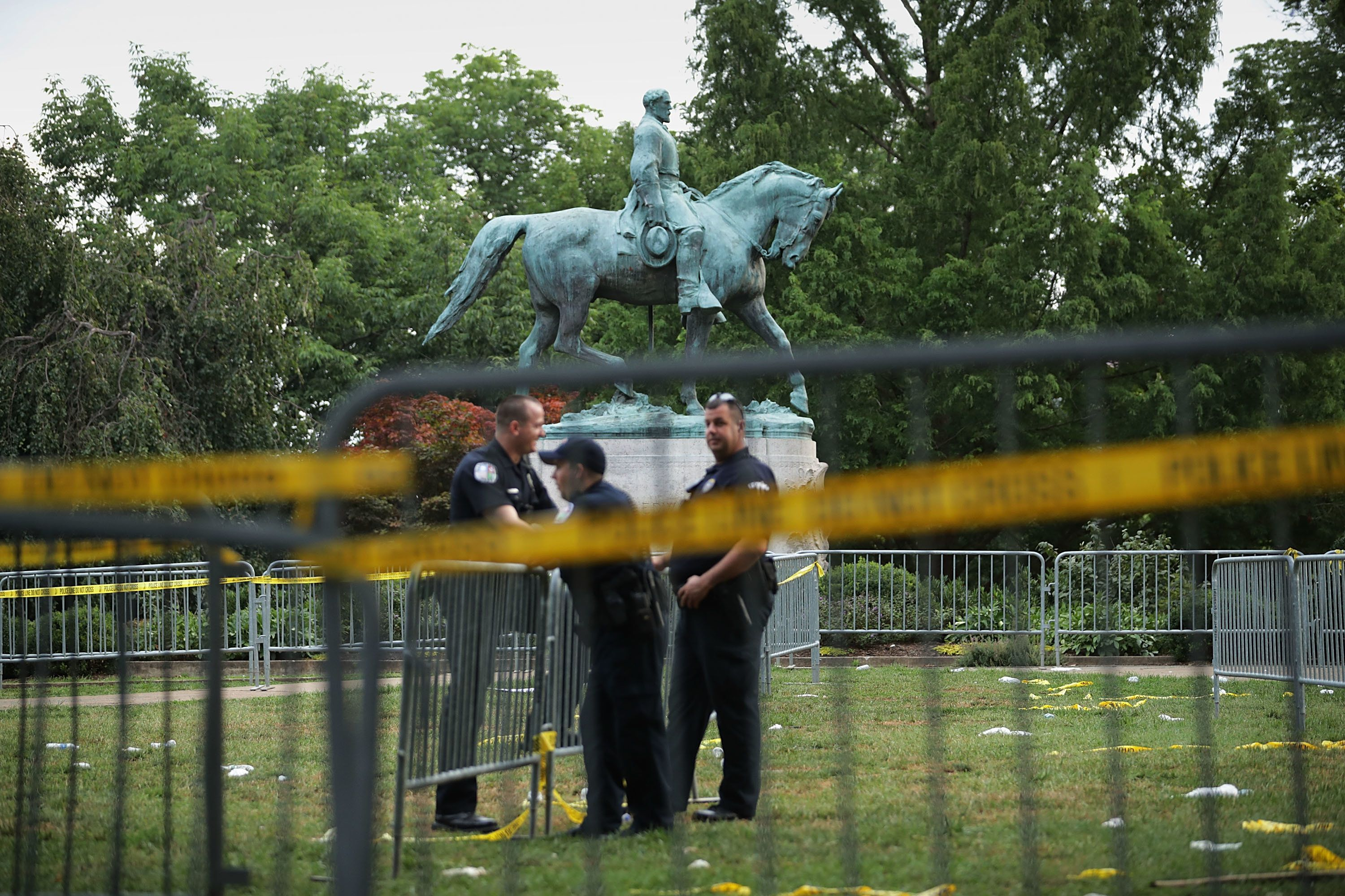CHARLOTTESVILLE, VA - AUGUST 13:  Police stand watch near the statue of Confederate Gen. Robert E. Lee in the center of Emancipation Park the day after the Unite the Right rally devolved into violence August 13, 2017 in Charlottesville, Virginia. The Charlottesville City Council voted to remove the statue and change the name of the space from Lee Park to Emancipation Park, sparking protests from white nationalists, neo-Nazis, the Ku Klux Klan and members of the 'alt-right.'  (Photo by Chip Somodevilla/Getty Images)
