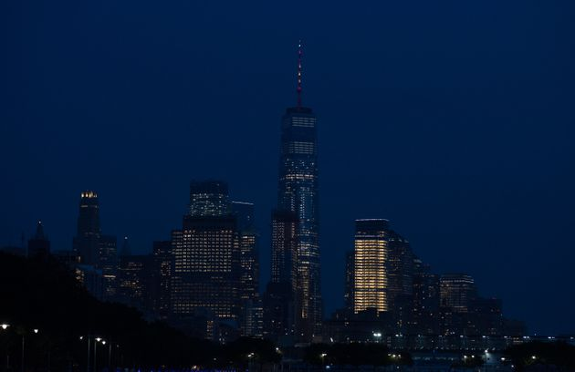 The spire atop One World Trade Center in New York City is lighted in the colors of the Spanish...
