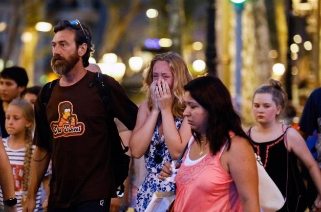 Witnesses of the Barcelona terror attack at the scene of the