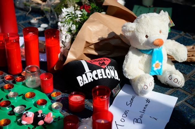 Flowers, candles, messages and stuffed toys are left on the Rambla boulevard following the attack which...