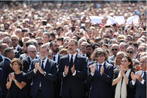 King Felipe of Spain and Prime Minister Mariano Rajoy observe a minute of silence following the Barcelona