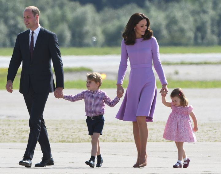 Prince William, Duke of Cambridge, the Duchess of Cambridge, Prince George and Princess Charlotte on the tarmac in Hamburg, Germany, on July 21.