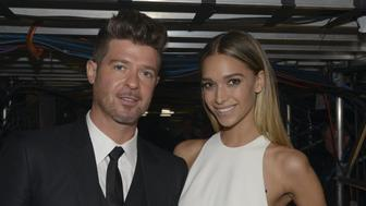 LOS ANGELES - FEBRUARY 15: Robin Thicke and April Joy Geary backstage during THE 58TH ANNUAL GRAMMY AWARDS, Monday, Feb. 15, 2016 (8:00-11:30 PM, live ET) at STAPLES Center in Los Angeles and broadcast on the CBS Television Network. (Photo by Timothy Kuratek/CBS via Getty Images)