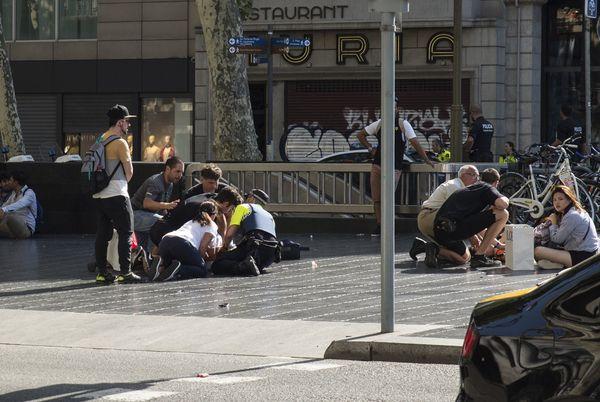 People help injured victims.