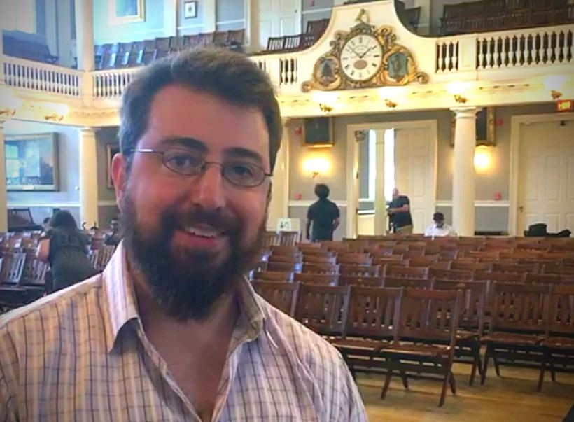 Photo caption: <em>Jeremy Fryer-Biggs of Evaptainers poses in Fanueil Hall following the conclusion of Boston GreenFest's Int