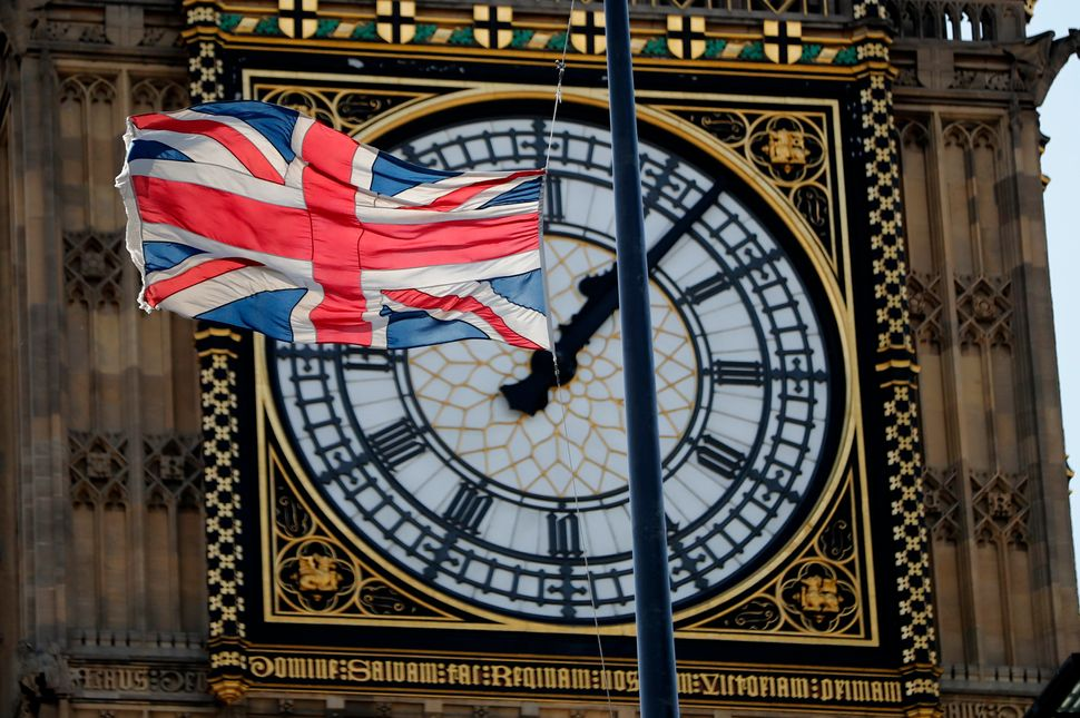 A Union flag flies at half-staff from the roof of the Elizabeth Tower, which houses the Big Ben bell, at the Palace of Westmi