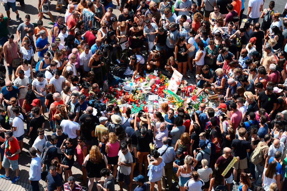 People leave candles, flowers, messages, stuffed toys and many differents objects for the victims in Las Ramblas on Friday.
