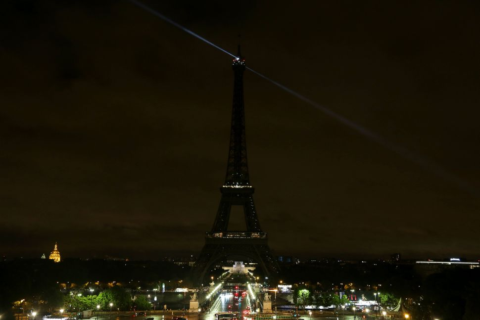 The lights of the Eiffel Tower in Paris are switched off in solidarity.