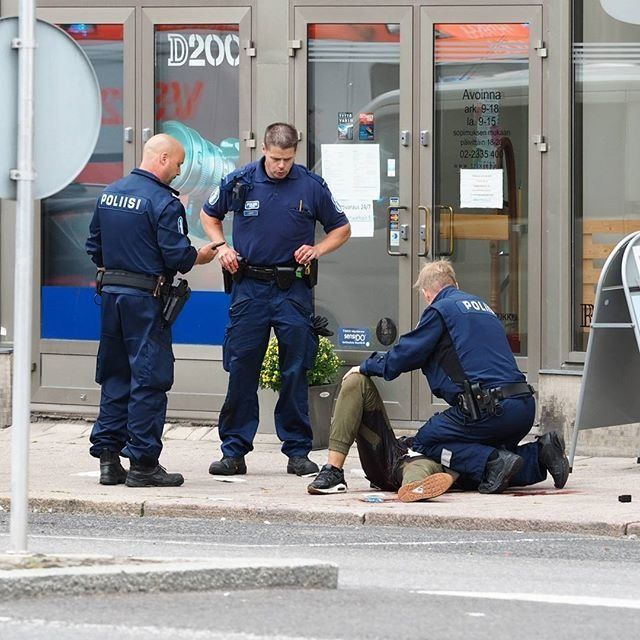Police at the scene of a stabbing in Turku, Finland, on Friday.