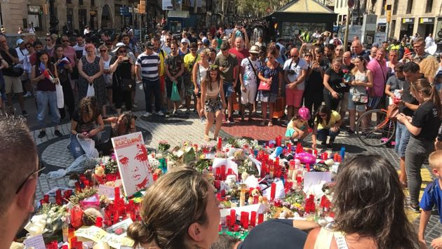 Mourners gather on Las Ramblas where the van stopped