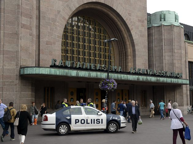 Finnish police patrols in front of the Central Railway Station in Helsinki, on August 18,
