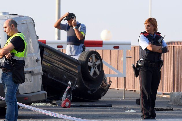 Police guard the car involved in the attack in Cambrils that killed one and left several people