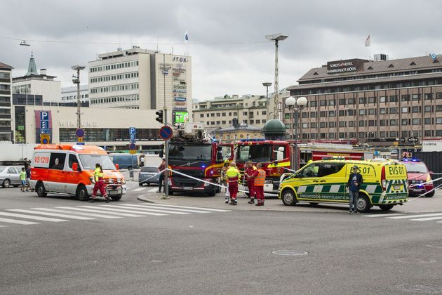 Rescue personnel have cordoned off the area at the Turku Market Square in the Finnish city of Turku where...