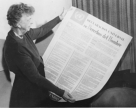Eleanor Roosevelt with the Spanish version of the Universal Declaration of Human Rights (1948).
