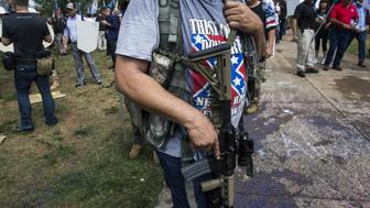 CHARLOTTESVILLE, USA - August 12: A White Supremacist open carries a rifle during clashes with counter protestors at Emancipation Park where the White Nationalists are protesting the removal of the Robert E. Lee monument in Charlottesville, Va., USA on August 12, 2017. (Photo by Samuel Corum/Anadolu Agency/Getty Images)