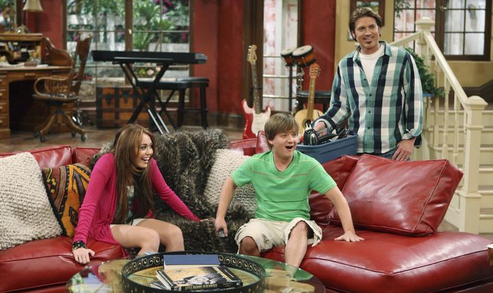 Jason Earles along with his costars Miley Cyrus and Billy Ray Cyrus.