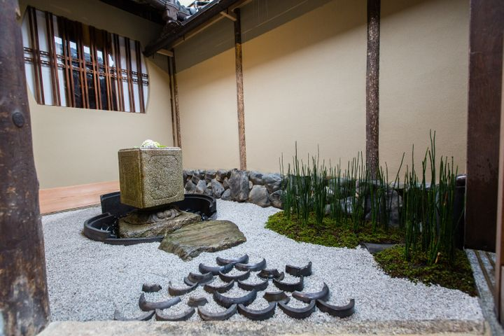 A view of one of the Japanese traditional gardens at Kyoto's traditional-style Starbucks branch.