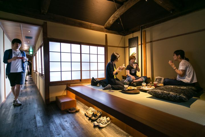 Customers sit inside Kyoto's new Starbucks branch during its grand opening on June 30, 2017.