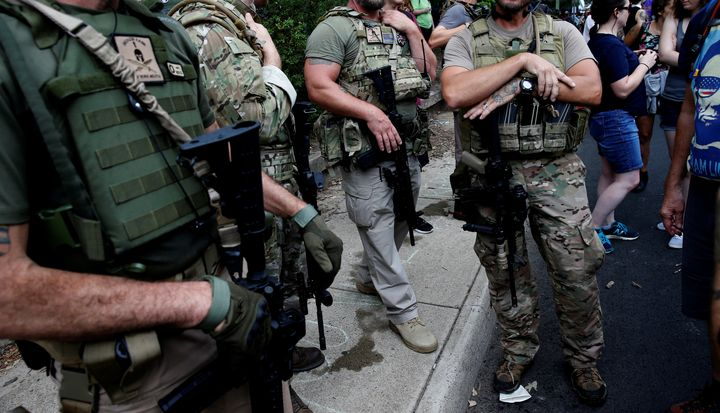 Members of a militia stand near a rally in Charlottesville, Virginia, U.S., August 12, 2017.