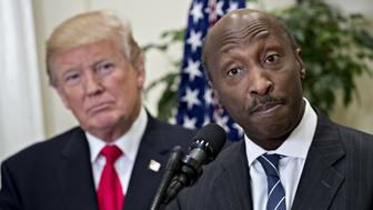 Ken Frazier, chairman and chief executive officer of Merck & Co., speaks while U.S. President Donald Trump, left, listens during an announcement on a new pharmaceutical glass packaging initiative in the Roosevelt Room of the White House in Washington, D.C., U.S., on Thursday, July 20, 2017. Trump announced an initiative led by Merck, Pfizer Inc. and Corning Inc. to manufacture pharmaceutical glass packaging in the U.S. with an immediate investment of at least $500 million dollars. Photographer: Andrew Harrer/Bloomberg via Getty Images