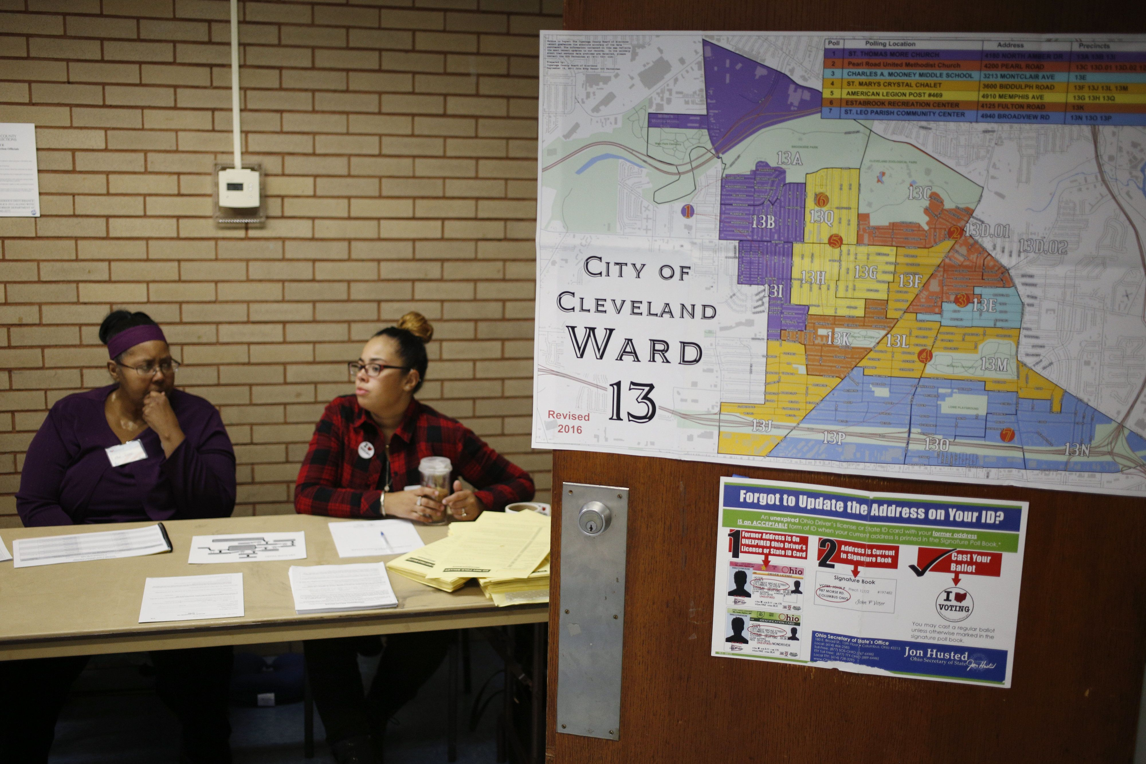 Election workers wait for voters to arrive at the Estabrook Recreation Center polling location in Cleveland, Ohio, U.S., on Tuesday, Nov. 8, 2016. The Justice Department will deploy 500 personnel to polling stations on Election Day to help protect voters against discrimination and intimidation, down from 2012 as the result of a Supreme Court ruling that gutted part of the 1965 Voting Rights Act. Photographer: Luke Sharrett/Bloomberg via Getty Images