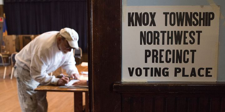 A voter registers in Alliance, Ohio, on Nov. 8, 2016. Ohio's process for purging voters from the rolls if they don't vote for