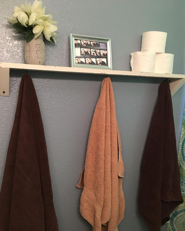 """Bathrooms can be very tiny, but there are still four walls of which you can take advantage. Consider installing hooks"