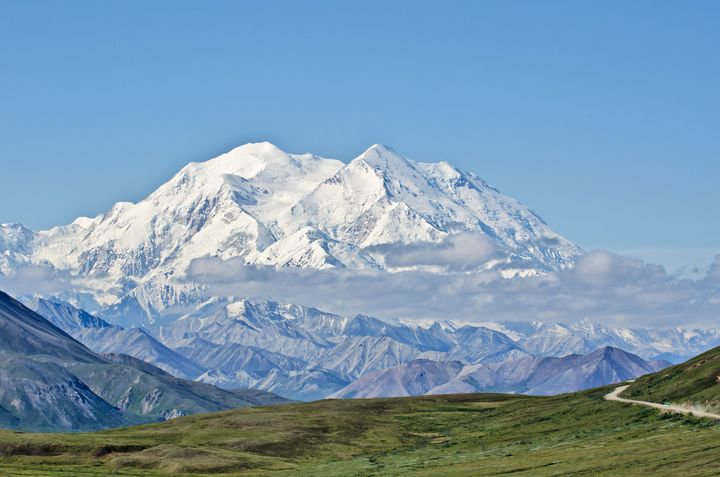 A view of Denali, formerly Mount McKinley, in Denali National Park, Alaska, with Park Road in the foreground leading to it.