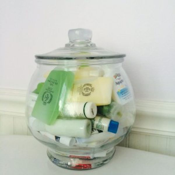 """Those minis can take over and clutter bathroom space. Store travel/trial size items in a clear decorative container in"