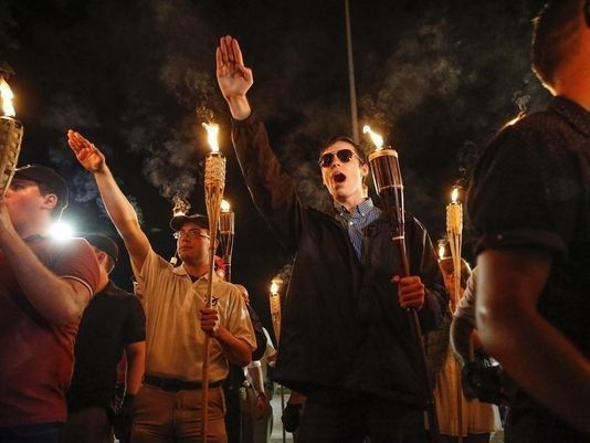 "A haunting image from the Unite the Right Rally in Charlottesville, where they marched chanting slogans such as ""Jews wi"