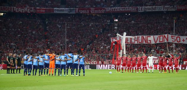 Bayern Munich and Beyer Leverkusen players during a minute silence for the victims of the Barcelona terror