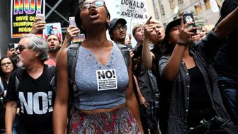 Anti-racism protesters shout during protests in front of Trump Tower in New York City, New York, U.S., August 14, 2017.  REUTERS/Shannon Stapleton     TPX IMAGES OF THE DAY