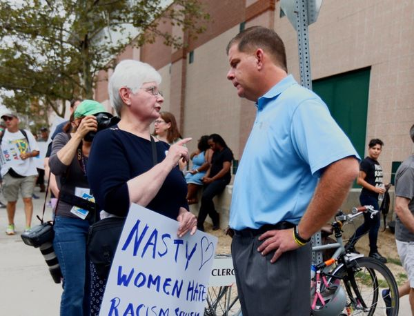 Boston Mayor Marty Walsh speaks with protesters.