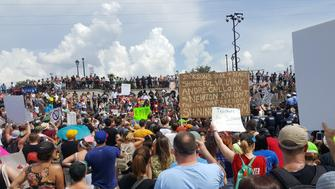 Demonstrators protesting racism and white supremacy marched from Congo Square to Jackson Square