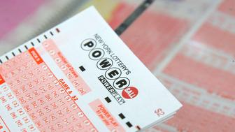 A ticket for the U.S. lottery Powerball sits on a counter in a store on Kenmare Street in Manhattan, New York, U.S., February 22, 2017. REUTERS/Andrew Kelly