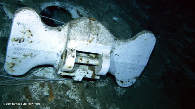 An image shot from a remotely operated vehicle shows the bottom of an anchor clearly marked US Navy and...