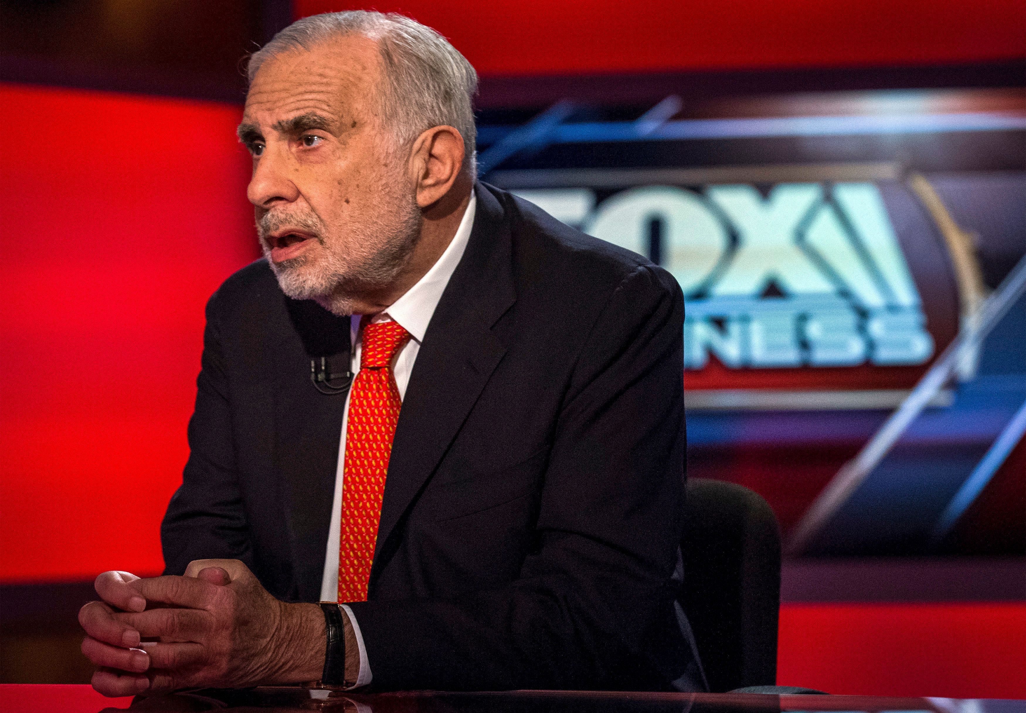 Billionaire activist-investor Carl Icahn gives an interview on FOX Business Network's Neil Cavuto show in New York February 11, 2014.  Icahn has backed off from his campaign urging Apple to increase its stock buybacks, citing the company's recent repurchases as well as an influential proxy adviser's call against his proposal.   REUTERS/Brendan McDermid (UNITED STATES - Tags: BUSINESS MEDIA)