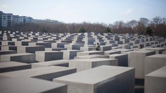 A visitor is seen among the concrete blocks in the Memorial to the Murdered Jews of Europe in Berlin, on January 26, 2017. The International Holocaust Remembrance Day will be commemorated on January 27, in accordance to the U.N General Assembly Resolution 60/7.***ISRAEL OUT*** (Photo by Omer Messinger/NurPhoto via Getty Images)