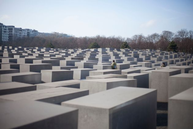 A visitor walks among the concrete blocks in the Memorial to the Murdered Jews of Europe in Berlin on...