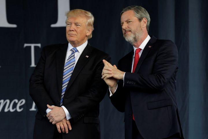 Liberty University President Jerry Falwell Jr. is seen standing with Trump following Trump's commencement speech.