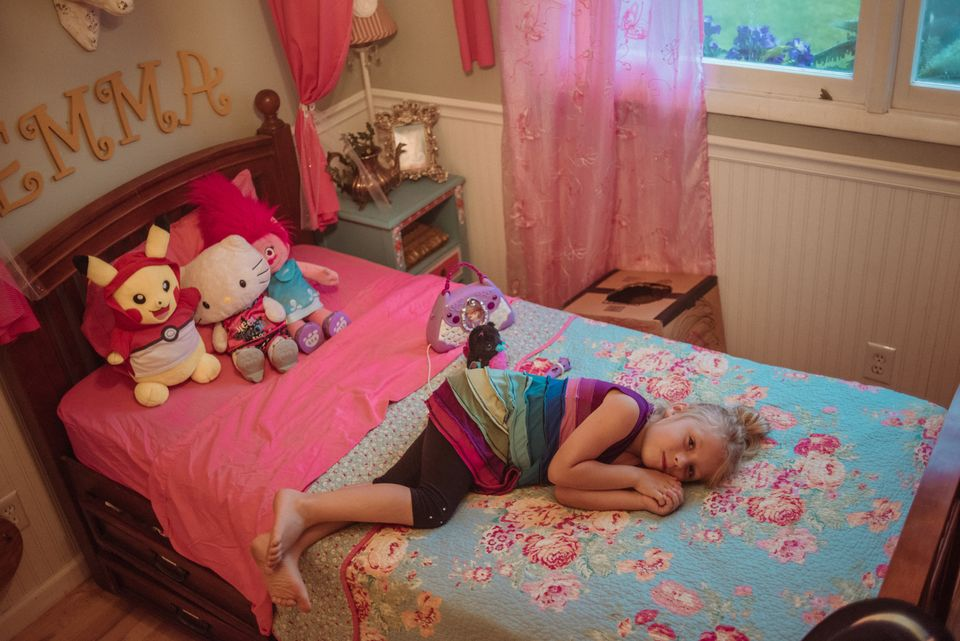 Emma lying on her bed at her home in Arden, North